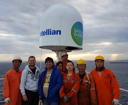 Smiling crew onboard vessel with Aura VSAT